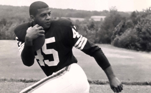 Ernie Davis carrying ball (NFL com)